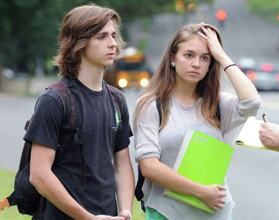 "Greenwich High School seniors, Sean Thomalen, left, and Cristina de la Vega, speak with a Greenwich Time reporter regarding the suicide of a fellow student, after dismissal from school, Wednesday afternoon, August 28, 2013. A Greenwich High School sophomore, widely reported to have been the victim of bullying, committed suicide after the first day of classes Tuesday. Bartlomiej ""Bart"" Palosz, 15, shot himself to death Tuesday night at his family's home in Byram, police said. Photo: Bob Luckey / Greenwich Time"