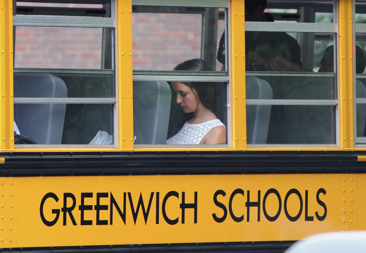 A Greenwich High School student rides the bus during dismissal, Wednesday afternoon, August 28, 2013. A Greenwich High School sophomore, widely reported to have been the victim of bullying, committed suicide after the first day of classes Tuesday. Bartlomiej