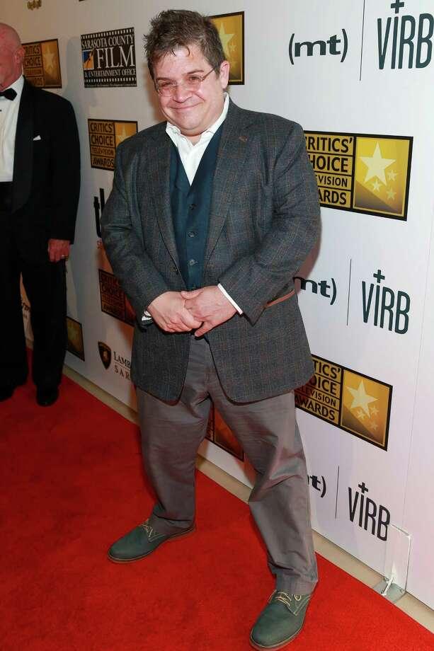 Actor Patton Oswalt, pictured June 10, 2013 in Beverly Hills, Calif. Photo: Imeh Akpanudosen, . / 2013 Imeh Akpanudosen