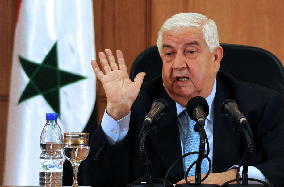 "Syrian Foreign Minister Walid Muallem speaks during a press conference in Damascus on August 27, 2013. Muallem said the government of Syrian President Bashar al-Assad, which has been fighting an insurgency for the past 29 months, had defences that would ""surprise"" the world. Photo: STR, AFP/Getty Images / 2013 AFP"