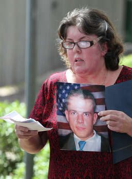 Gale Hunt hold a photograph of her son, Spc. Jason Hunt, after Maj. Nidal Hasan is sentenced to death for capital murder at a trial in Fort Hood, Texas, Wednesday, Aug. 28, 2013.  Photo: Jerry Lara, San Antonio Express-News / ©2013 San Antonio Express-News