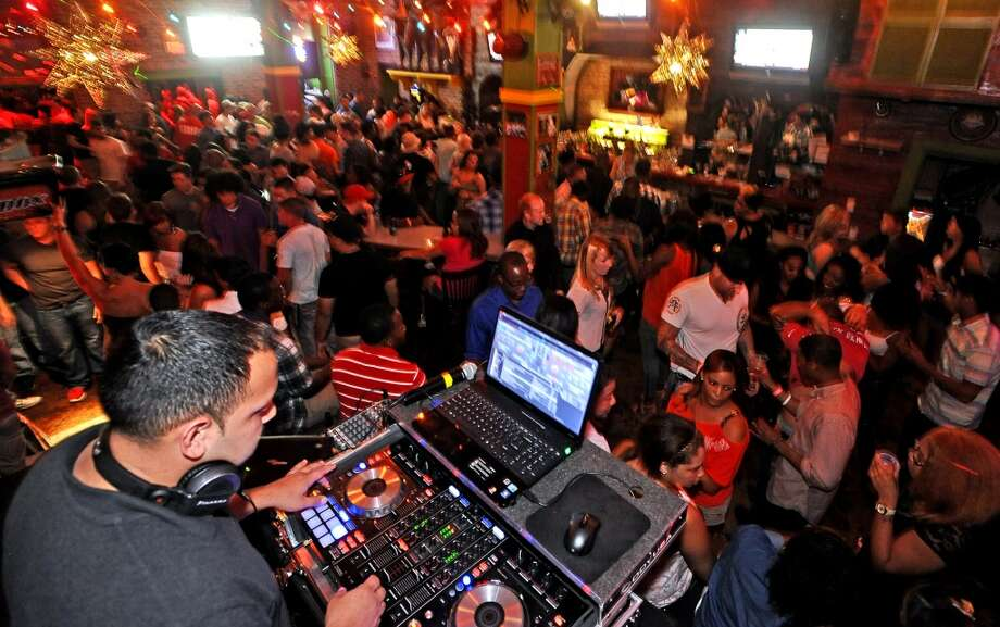 DJ Outbreak mixing live on College Night at Tequila Rok on Crockett Street.  Photo taken Thursday, August 22, 2013. Photo taken: Randy Edwards/The Enterprise Photo: Randy Edwards, Beaumont Enterprise