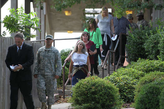 Victims' family members head to a press conference after Maj. Nidal Hasan is sentenced to death for capital murder at a trial in Fort Hood, Texas, Wednesday, Aug. 28, 2013. Photo: Jerry Lara, San Antonio Express-News / ©2013 San Antonio Express-News