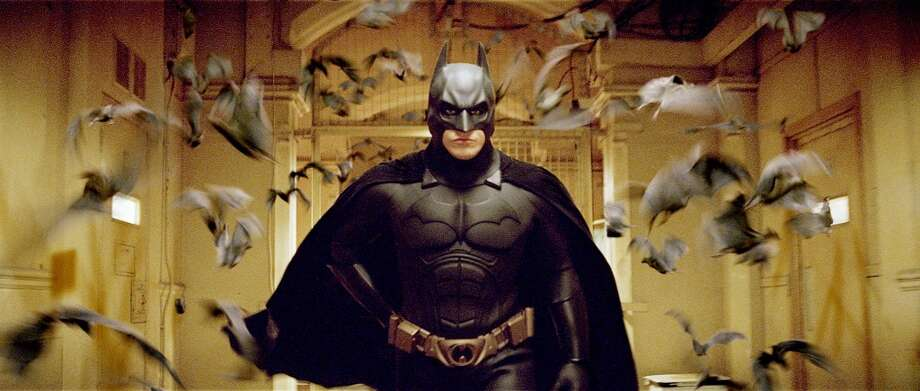 "For Christoper Nolan's reboot ""Batman Begins"", the batsuit's color palette changed from a glossy black to a flat black. The bat symbol and the cape's material were changed. Christian Bale played Batman for all three of Nolan's movies. Photo: Warner Bros. Pictures"