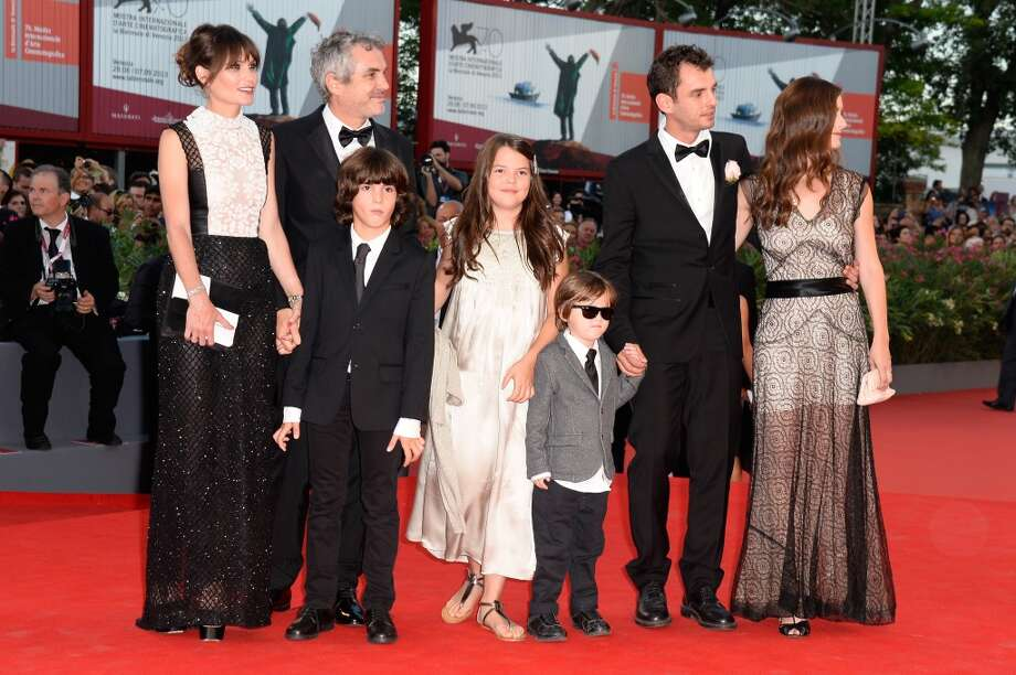 Sheherazade Goldsmith, director Alfonso Cuaron with their children, screenwriter Jonas Cuaron with his wife Eireann Harper and their son attend the Opening Ceremony And 'Gravity' Premiere during the 70th Venice International Film Festival at the Palazzo del Cinema on August 28, 2013 in Venice, Italy.  (Photo by Pascal Le Segretain/Getty Images) Photo: Pascal Le Segretain, Getty Images