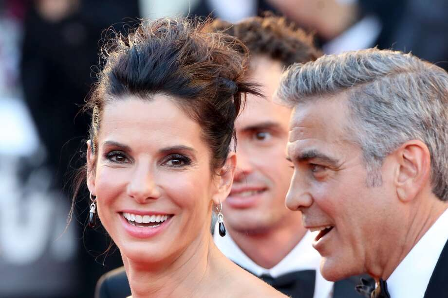 Actors George Clooney and Sandra Bullock attend the Opening Ceremony And 'Gravity' Premiere at Palazzo del Cinema on August 28, 2013 in Venice, Italy.  (Photo by Franco Origlia/Getty Images) Photo: Franco Origlia, Getty Images