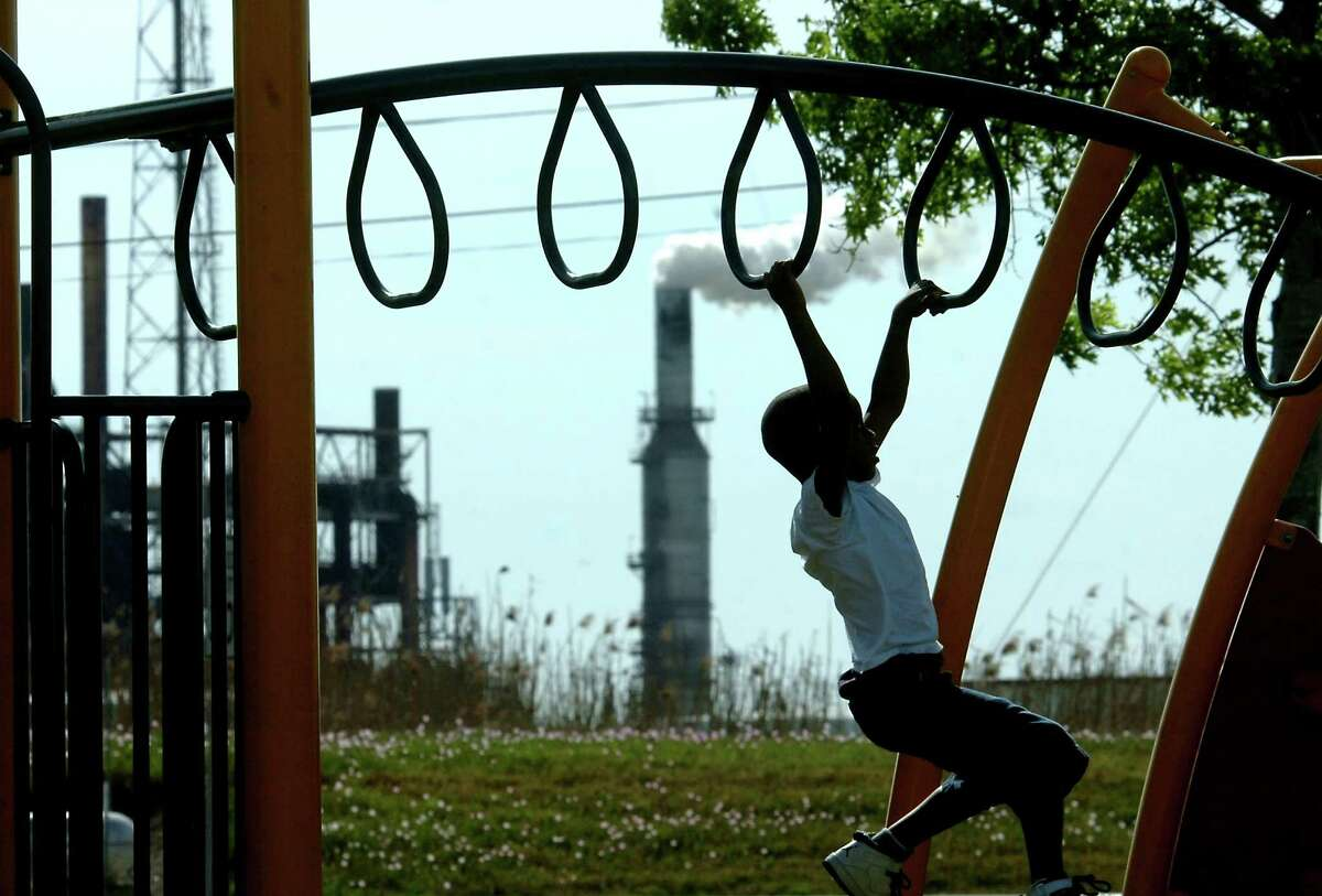 Korwin Thomas plays on the playground on West 15th in Port Arthur in 2011. Enterprise file photo.