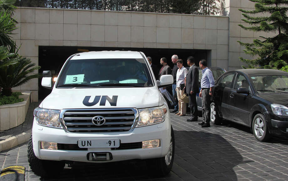A convoy of United Nations (UN) vehicles leave a hotel in Damascus on August 28, 2013 carrying UN inspectors travelling to a site in the Syrian capital of alleged chemical weapons attacks, a day after suspending their mission over safety concerns. The team of arms experts boarded a convoy of six vehicles, but it was unclear which site they were intending to visit after braving sniper fire two days ago when they began their mission by visiting two field hospitals in Moadamiyet al-Sham, southwest of Damascus, where they collected evidence of last week's suspected chemical attacks. Photo: STR, AFP/Getty Images / 2013 AFP