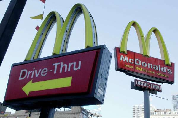 """FILE - In this Dec. 20, 2010 file photo, McDonald's signs sprout from the restaurant's parking lot in New York. McDonald's says a key sales figure edged up modestly in July, 2013, as the Dollar Menu and Big Macs in the U.S. helped offset declines in other parts of the world.  The world's biggest hamburger chain says global sales rose 0.7 percent at restaurants open at least 13 months. That included a 1.6 percent increase in the U.S., where it said """"everyday value offerings,"""" breakfast and staples such as the Big Mac drove up results.  (AP Photo/Richard Drew, file) ORG XMIT: NY112"""