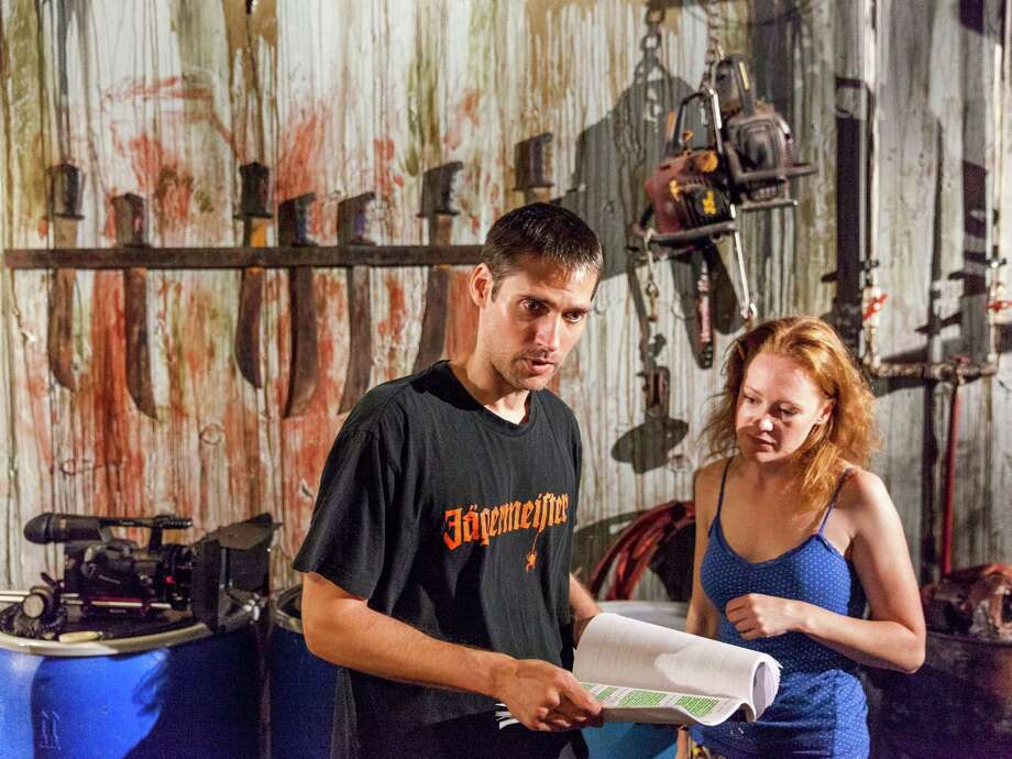 "Kerry Beyer and Kelly Byrns discuss a scene on the set of the psychological thriller ""Killing Mr. Right"" filmed at ScreamWorld on the Sam Houston Parkway. (Craig H. Hartley) Photo: Craig Hartley, Freelance / Copyright: Craig H. Hartley"