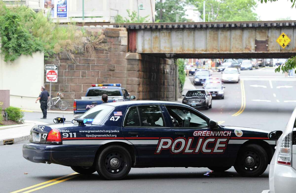 A Greenwich Police car parked on Steamboat Road during the aftermath of a bank robbery at the People's United Bank branch at the bottom of Greenwich Avenue, Wednesday, Aug. 28, 2013. The bank was robbed shortly before 5 p.m. and a police search for the suspect forced the closure of the nearby Metro-North New Haven Line.