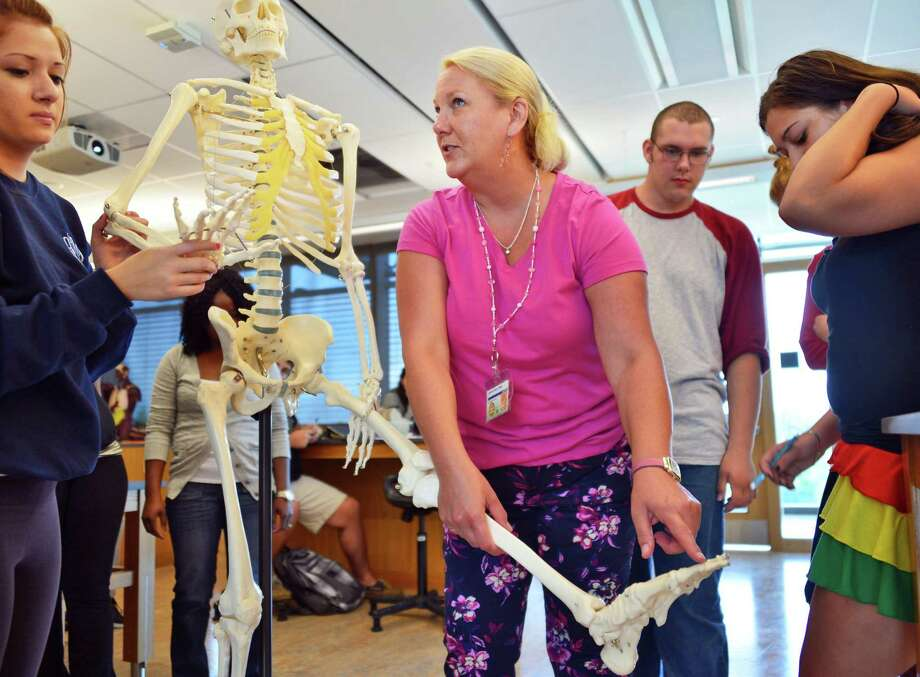 Dr. Nola Kelly, center, teaching a human biology class in Hudson Valley Community College's new Science Center Tuesday morning, Aug. 27, 2013, in Troy, NY.  (John Carl D'Annibale / Times Union) Photo: John Carl D'Annibale / 00023648A