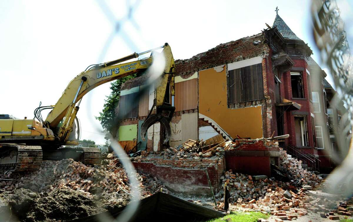 Demolition begins on the remaining buildings to clear the way for a Price Chopper supermarket on Wednesday, Aug. 28, 2013, in Watervliet, N.Y. (Cindy Schultz / Times Union)