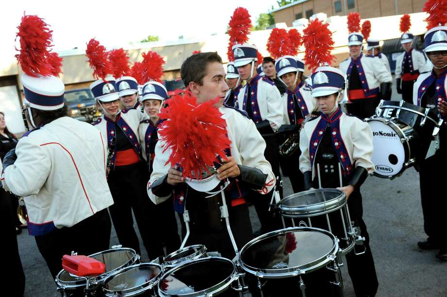 Devin FitzGerald, 17, center, gets ready to play the tenor drums with the Schenectady High School Marching Band on Friday, Aug. 23, 2013, at Schenectady High School in Schenectady, N.Y. (Cindy Schultz / Times Union) Photo: Cindy Schultz / 00023624A