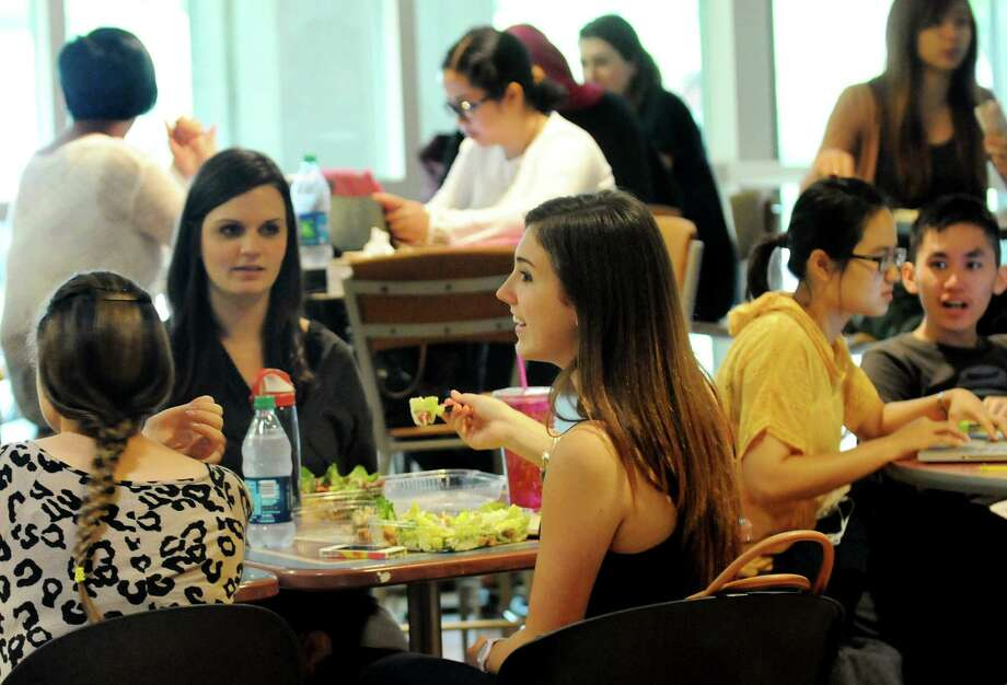 Brittany Kraiza, 22, center, eats a salad from Stalks and Stems as she joins fellow graduate students Lindsay Danielson, 20, left, and Brittany Kendall, 23, second from left, for lunch on Tuesday, Aug. 27, 2013, at the University at Albany campus in Albany, N.Y. (Cindy Schultz / Times Union) Photo: Cindy Schultz / 00023632A