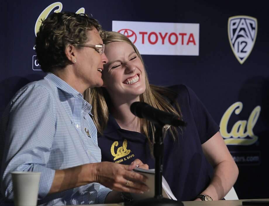 Four-time Olympic gold-medalist Missy Franklin, who's starting her freshman year at Cal, enjoys a moment with swimming coach Teri McKeever at a news conference. Photo: Paul Chinn, The Chronicle