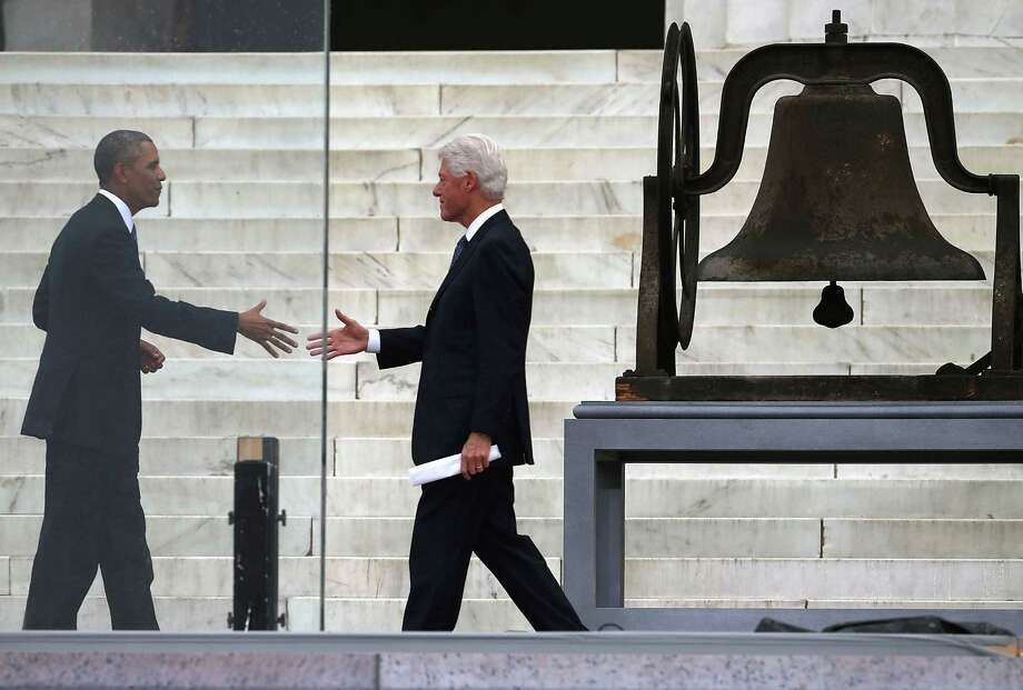 "President Barack Obama (L) shakes hands with former U.S. President Bill Clinton during the ceremony to commemorate the 50th anniversary of the March on Washington for Jobs and Freedom August 28, 2013 in Washington, DC. It was 50 years ago today that Martin Luther King, Jr. delivered his ""I Have A Dream Speech"" on the steps of the Lincoln Memorial. Photo: Mark Wilson, Getty Images / 2013 Getty Images"