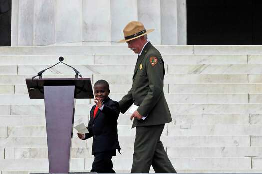 Robby Novak, also known as Kid President, and National Park National Park Service Director Jonathan B. Jarvis, take the stage for the 50th Anniversary of the March on Washington where Martin Luther King, Jr., spoke, Wednesday, Aug. 28, 2013, in front of the Lincoln Memorial in Washington. Photo: Charles Dharapak, Associated Press / AP