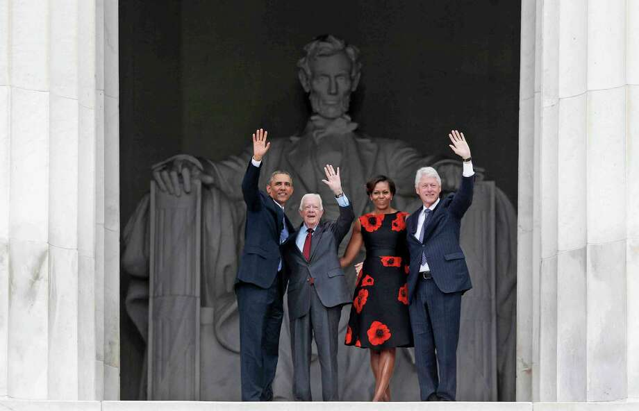 President Barack Obama, first lady Michelle Obama, former President Jimmy Carter and former President Bill Clinton wave as they leave 50th Anniversary of the March on Washington where Martin Luther King Jr., spoke, Wednesday, Aug. 28, 2013, at  the Lincoln Memorial in Washington. Photo: Charles Dharapak, Associated Press / AP