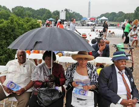 From left to right: Stanley Samuels and Rita Samuels, from Atlanta, Ga.; Sammie Whiting-Ellis, from Washington, D.C.; and Henry H. Brown, from Houston, Texas; who attended the March on Washington 50 years ago where Martin Luther King, Jr., spoke, wait for the anniversary program to begin in front of the Lincoln Memorial in Washington, Wednesday, Aug. 28, 2013. Photo: Charles Dharapak, Associated Press / AP