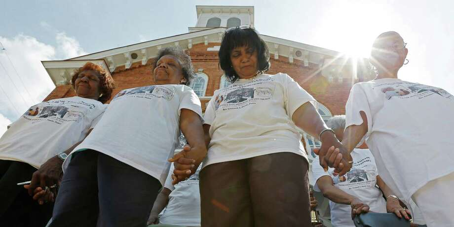 "Members of the Dexter Ave. King Memorial Baptist Church pray during a bell ringing ceremony in Montgomery, Ala., Wednesday, Aug. 28, 2013. The ceremony honors the 50th anniversary of the March on Washington and the ""I Have a Dream"" speech by Rev. Martin Luther King Jr., who was pastor at this church in 1954. Photo: Dave Martin, Associated Press / AP"