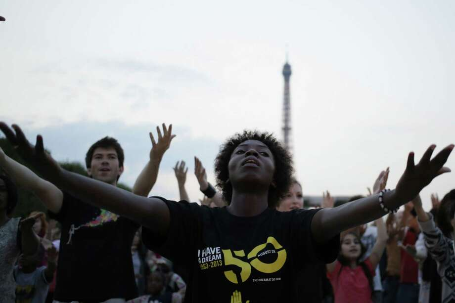 "People dance as they take part in a flashmob to commemorate the 50th anniversary of the March on Washington and Dr. Martin Luther King Jr.'s ""I have a Dream"" speech on August 28, 2013 in Paris. Photo: KENZO TRIBOUILLARD, AFP/Getty Images / AFP PHOTO"