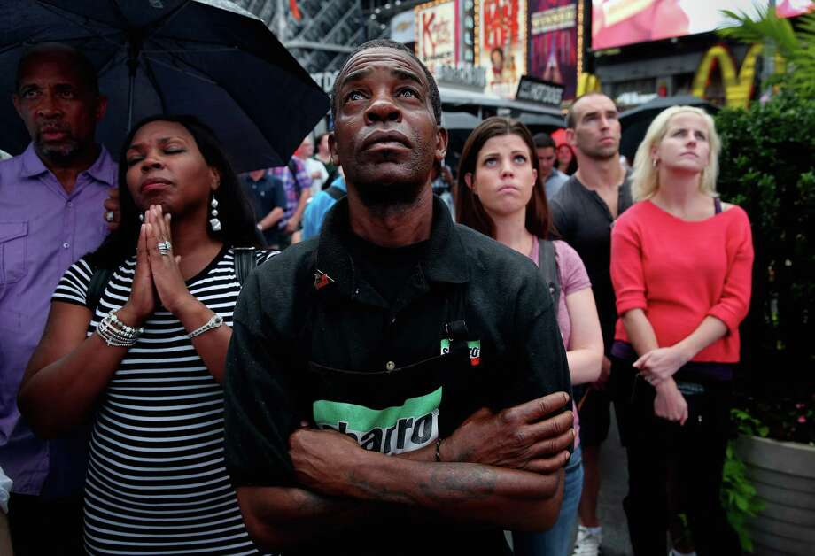 "Richard Bailey, from Hempstead, New York, watches a giant screen in Times Square as U.S. President Barack Obama speaks on the 50th anniversary of Martin Luther King Jr.'s ""I Have a Dream"" speech on August 28, 2013 in New York City. With the official ceremony in Washington D.C., a crowd gathered in Manhattan's Times Square to watch the President's speech broadcast live and commemorate the anniversary of what is seen as one of the most important days in the history of American civil rights. Photo: John Moore, Getty Images / 2013 Getty Images"