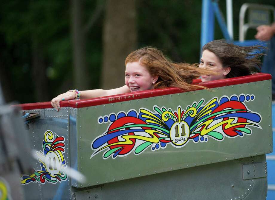 Sarah Molloy, 12, left, and Allie Gold, 12, right, ride the Scrambler at the St. Leo summer fair on Wednesday, August 28, 2013. The fair runs through Saturday, August 31, 2013. Photo: Lindsay Perry / Stamford Advocate