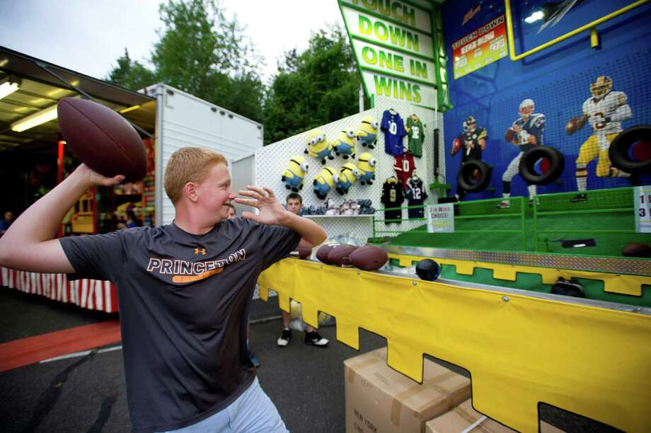 Matt Harmonay, 14, plays a game at the St. Leo summer fair on Wednesday, August 28, 2013. The fair runs through Saturday, August 31, 2013. Photo: Lindsay Perry / Stamford Advocate