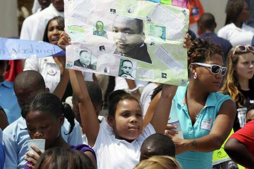 Nyla Washington, 10, of Little Rock, Ark., holds a poster she made showing Rev. Martin Luther King at the Arkansas state Capitol in Little Rock, Ark., Wednesday, Aug. 28, 2013. Hundreds gathered at the Capitol to mark the 50th anniversary of the March on Washington. Photo: Danny Johnston, Associated Press / AP