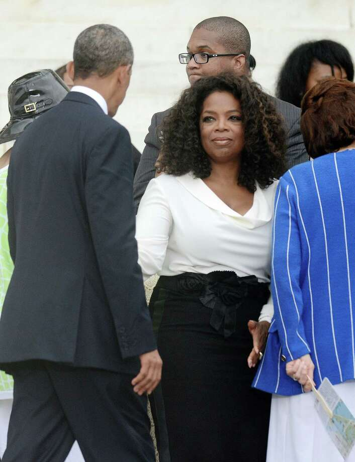 "President Barack Obama greets Oprah Winfrey during the ""Let Freedom Ring"" ceremony to commemorate the 50th anniversary of the March on Washington for Jobs and Freedom at the Lincoln Memorial on the National Mall on August 28, 2013 in Washington, D.C. Photo: Olivier Douliery, McClatchy-Tribune News Service / Abaca Press"