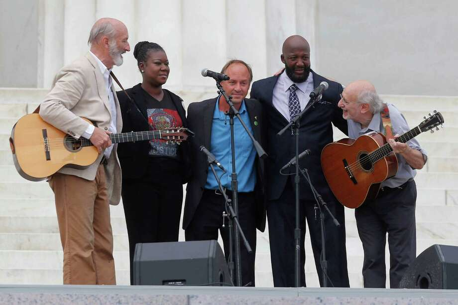 With Trayvon Martin parents, Sybrina Fulton, and Tracy Martin, and Mark Barden, father of Sandy Hook Elementary School shooting victim Daniel Barden, Peter Yarrow, left, and Paul Stookey, right, of the folk trio Peter, Paul and Mary, perform at the 50th Anniversary of the March on Washington where Martin Luther King, Jr., spoke, Wednesday, Aug. 28, 2013, in front of the Lincoln Memorial in Washington. Photo: Charles Dharapak, Associated Press / AP