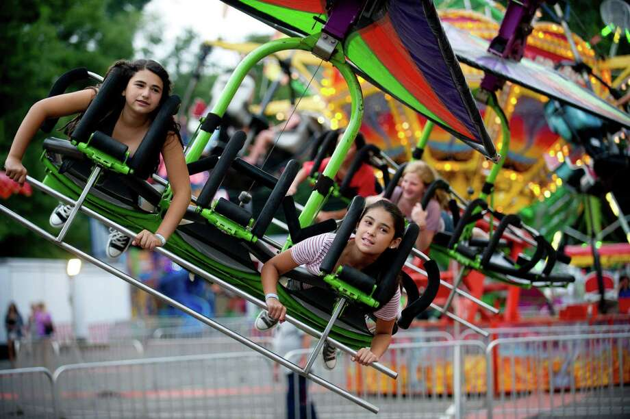 Fair-goers take a ride at the St. Leo summer fair on Wednesday, August 28, 2013. The fair runs through Saturday, August 31, 2013. Photo: Lindsay Perry / Stamford Advocate
