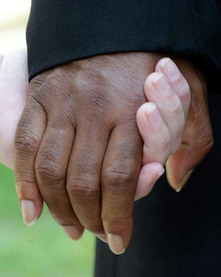 "People of mixed races hold hands during a prayer outside the Dexter Ave. King Memorial Baptist Church in Montgomery, Ala., Wednesday, Aug. 28, 2013. Members were holding a bell ringing ceremony to honor the 50th anniversary of the ""I Had a Dream"" speech by Rev. Martin Luther King Jr., who was pastor of the church in 1954. Photo: Dave Martin, Associated Press / AP"