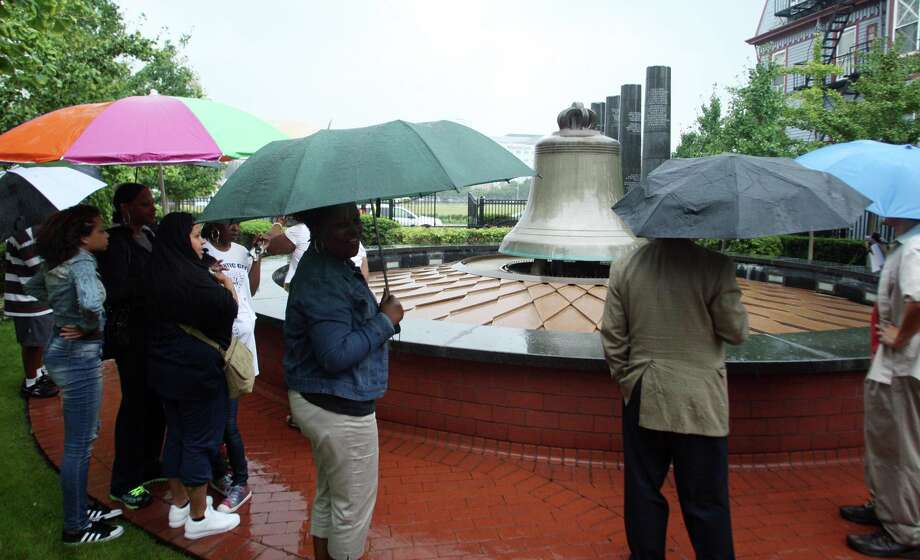 "People take part in a ""freedom ring"" bell-ringing ceremony at the Civil Rights Garden in Atlantic City, N.J. to mark 50 years since Dr. Martin Luther King delivered his ""I Have A Dream"" speech in Washington, Wednesday, Aug. 28, 2013. Photo: Edward Lea, Associated Press / The Press of Atlantic City"