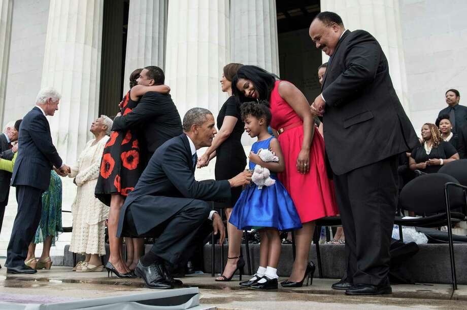 "US President Barack Obama talks with Yolanda Renee King while her father Martin Luther King III (R) and mother Arndrea Waters (2R) watch after speaking at the Lincoln Memorial on the National Mall August 28, 2013 in Washington, DC. Obama and others spoke to commemorate the 50th anniversary of the US civil rights era March on Washington where Martin Luther King Jr. delivered his ""I Have a Dream Speech"". Photo: BRENDAN SMIALOWSKI, AFP/Getty Images / 2012 Brendan Smialowski"