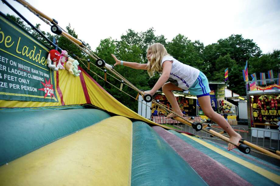 Ali Marzen, 9, tries the Rope Ladder at the St. Leo summer fair on Wednesday, August 28, 2013. The fair runs through Saturday, August 31, 2013. Photo: Lindsay Perry / Stamford Advocate