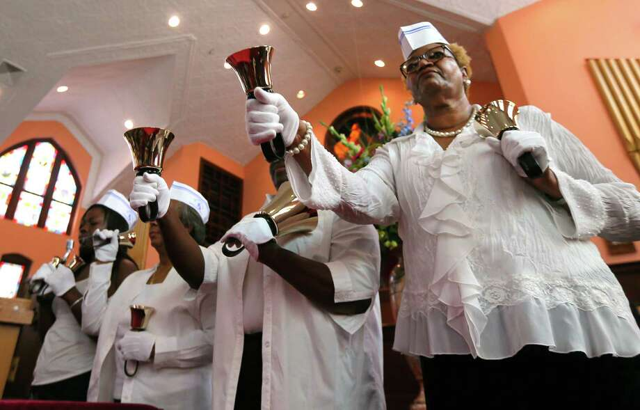 "From left, Sherita Jordan, Cynthia Terry, Sherri Jordan and Gwendolyn Morgan, members of the Christine King Farris Adult Handbell Choir, perform the bell ringing ""Let Freedom Ring"" at Ebenezer Baptist Church in commemoration of when Martin Luther King Jr. delivered his ""I Have a Dream"" speech fifty years ago, Wednesday, Aug. 28, 2013, in Atlanta. The speech was a rousing call to arms that bolstered the growing civil rights movement, and many argue it helped lead to major legislation passed by Congress a few years later. Photo: CURTIS COMPTON / AJC, Associated Press / Atlanta Journal-Constitution"