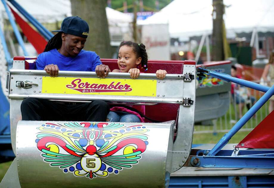 Tristan Jack rides the Scrambler with his daugther, Savanna, 5, at the St. Leo summer fair on Wednesday, August 28, 2013. The fair runs through Saturday, August 31, 2013. Photo: Lindsay Perry / Stamford Advocate