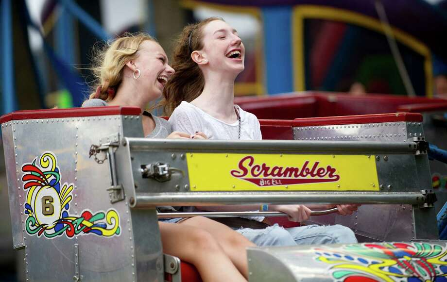 Nicole Somerstein, 13, left, and Hayley Smith, 14, right, ride the Scrambler at the St. Leo summer fair on Wednesday, August 28, 2013. The fair runs through Saturday, August 31, 2013. Photo: Lindsay Perry / Stamford Advocate