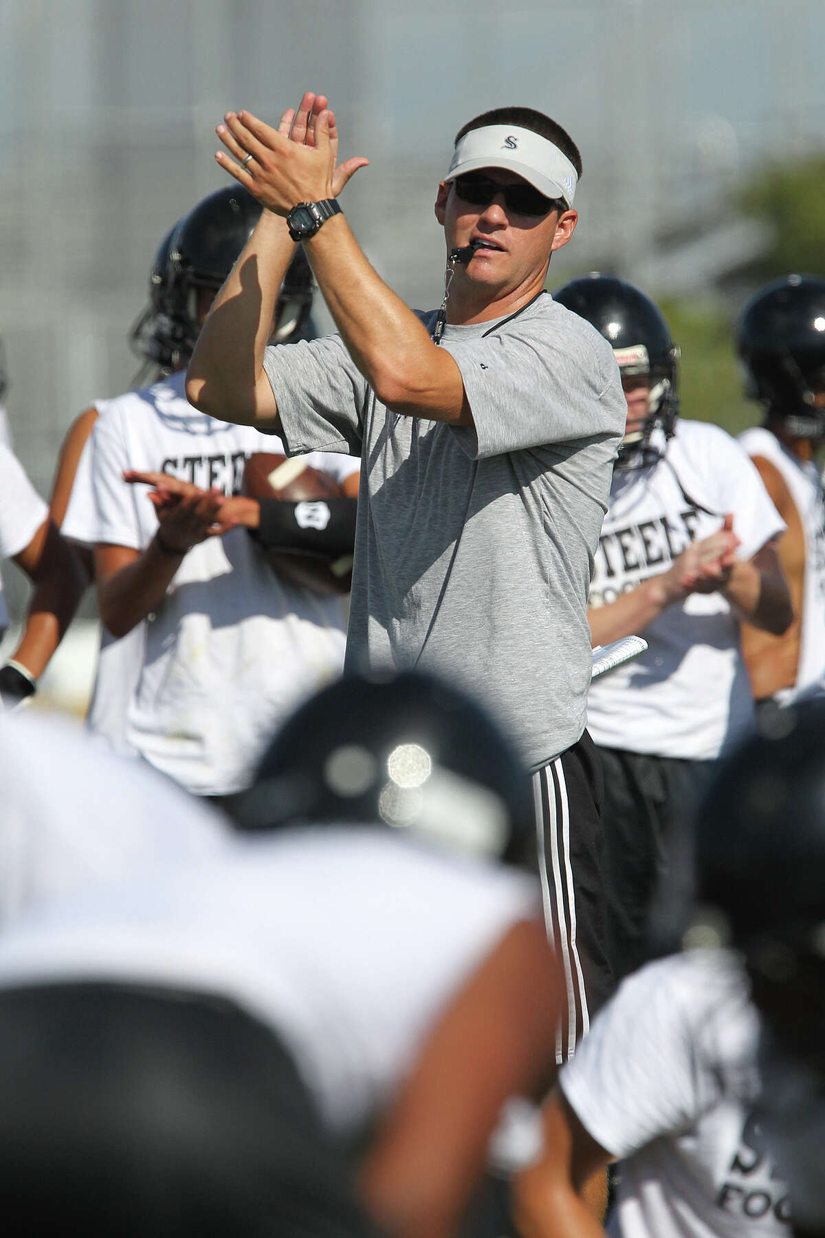 Steele High School Head Football Coach Scott Lehnhoff goes through the team's first practice of the season, Monday, Aug. 12, 2013. Lehnhoff took over the team after Mike Jinks left for Texas Tech University. The Knights have a 43-4 record in the past three years.