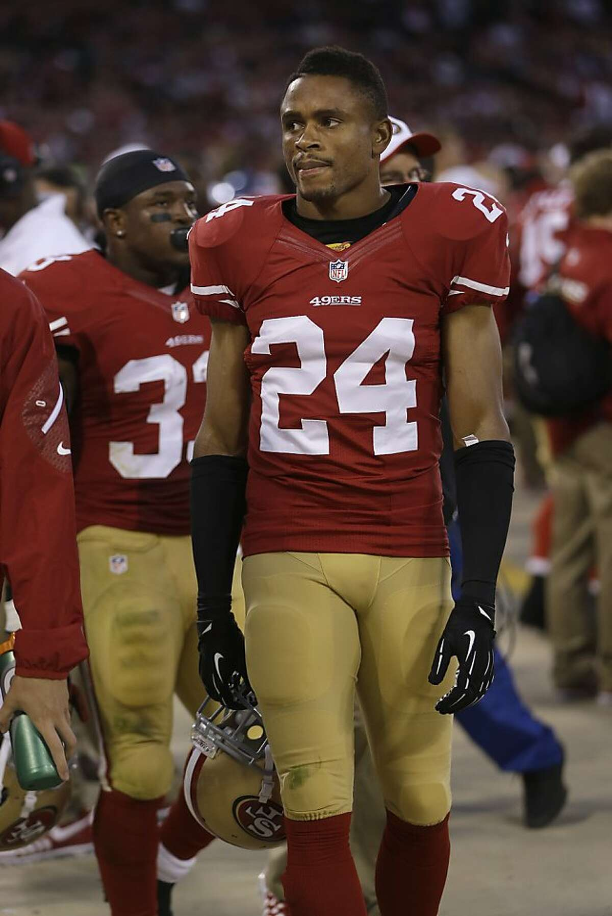 San Francisco 49ers cornerback Nnamdi Asomugha (24) walks on the sideline during the fourth quarter of an NFL preseason football game against the Minnesota Vikings in San Francisco, Sunday, Aug. 25, 2013. (AP Photo/Marcio Jose Sanchez)