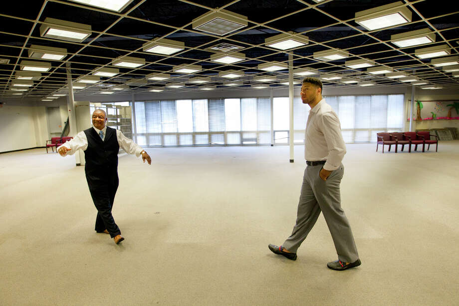 Bee Busy Wellness Center CEO Norman Mitchell, left, shows NBA player Royce White around the facility that bears his name. Photo: Cody Duty, Staff / © 2013 Houston Chronicle