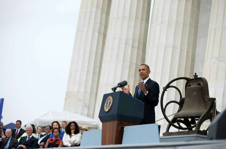 "President Barack Obama gestures while speaking during a ceremony commemorating the 50th anniversary of the March on Washington, Wednesday, Aug. 28, 2013, at the Lincoln Memorial in Washington. The president was set to lead civil rights pioneers Wednesday in a ceremony for the 50th anniversary of the March on Washington, where Dr. Martin Luther King's ""I Have a Dream"" speech roused the 250,000 people who rallied there decades ago for racial equality. (AP Photo/Evan Vucci) ORG XMIT: DCEV112 Photo: Evan Vucci / AP"