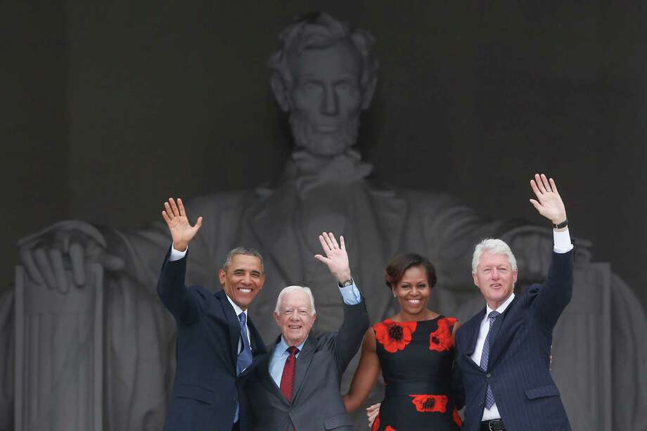 President Barack Obama and first lady Michelle Obama, former President Jimmy Carter and former President Bill Clinton acknowledge the crowd as they leave Wednesday's celebration at the Lincoln Memorial. Photo: Charles Dharapak, STF / AP