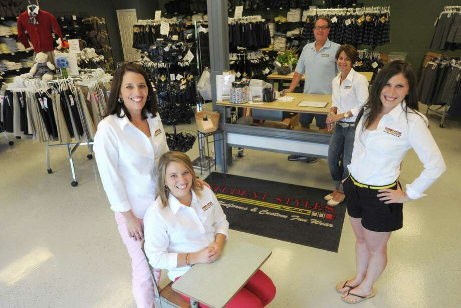 The staff at Student Styles by Smith, left to right, Christi Smith, Alex Smith, Kevin Smith, Karin Witte and Jen Smith on Friday Aug. 16, 2013 in Latham, N.Y.(Michael P. Farrell/Times Union) Photo: Michael P. Farrell / 00023517A