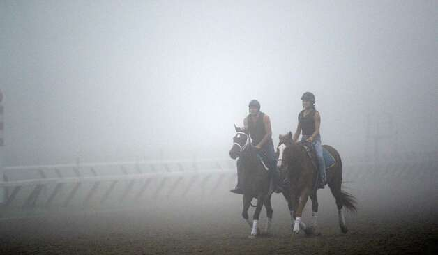 Fog shrouds the main track Wednesday morning, Aug 28, 2013, at Saratoga Race Course in Saratoga Springs, N.Y.  (Skip Dickstein/Times Union) Photo: SKIP DICKSTEIN / 00023666A
