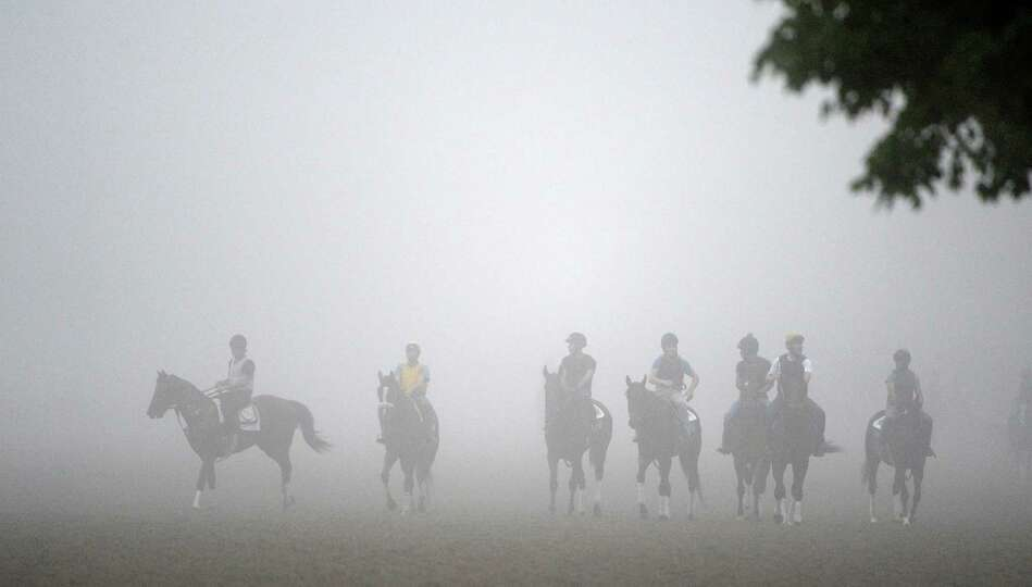 Fog shrouds the main track Wednesday morning, Aug 28, 2013, at Saratoga Race Course in Saratoga Spri
