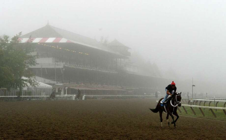 Fog shrouds the clubhouse on the main track Wednesday morning, Aug 28, 2013, at Saratoga Race Course in Saratoga Springs, N.Y.  (Skip Dickstein/Times Union) Photo: SKIP DICKSTEIN