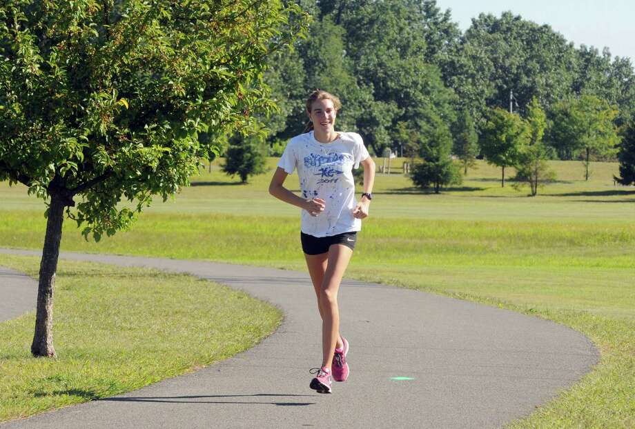 Shaker High School cross country runner Maryanna Lansingon trains at The Crossings on Saturay Aug. 24, 2013 in Colonie, N.Y. (Michael P. Farrell/Times Union) Photo: Michael P. Farrell / 00023620A